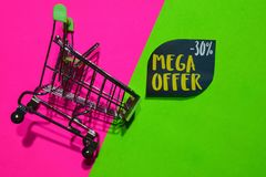 Mega Offer -30% Off Text and Shopping cart. Discount and promotion business concept on colorful background. N royalty free stock images