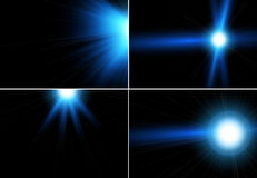 Mega- Sammlung blaue Blendenfleckstrahlen und -blitze auf schwarzem Hintergrund Stockfotografie