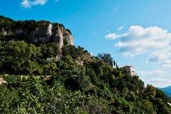 Mega Spilaio Monastery, Kalavryta, Peloponnese, Greece. Residential building at the Greek Orthodox Mega Spilaio Monastery, Kalavryta, Greece, with bare rocky royalty free stock image