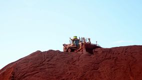 A Mega Tractor pushing Iron Ore stock footage