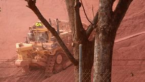 A Mega Tractor pushing Iron Ore in Weipa stock video footage
