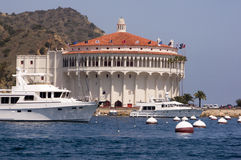Mega Yacht at Avalon Harbor. Starboard view of mega yacht in front of the historic Casino Building in Avalon Harbor, Catalina Royalty Free Stock Photos