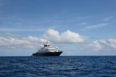 Mega yacht on blue ocean stock photo