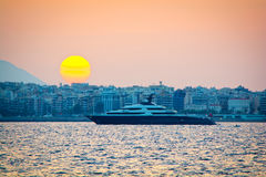 Mega-yacht. View of a mega-yacht outside of the port at sunset stock photo
