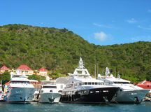 Mega yachts in   Gustavia Harbor at St. Barths Royalty Free Stock Photo