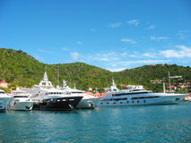 Mega yachts in   Gustavia Harbor at St. Barths Royalty Free Stock Image