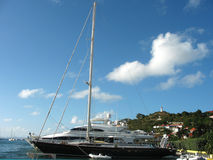 Mega yachts in Gustavia Harbor at St. Barts Stock Images