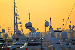 Mega-yachts. View of luxury mega-yachts in a marina in Greece at the sunset Royalty Free Stock Image