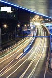 Megacity Highway at night with light trails. Large urban highway viaduct light trails night scene Royalty Free Stock Photography