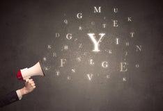 Megafon med bokstäver Arkivfoto