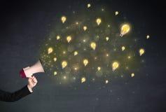 Megafon med lightbulbs Arkivfoto