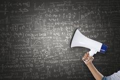 Megafon med matematisk formel på svart tavla Royaltyfria Bilder