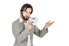 Megafono della tenuta dell'uomo espressione di emozione e stile di vita umani co Fotografie Stock