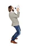 Megafono della tenuta dell'uomo espressione di emozione e stile di vita umani co immagine stock libera da diritti