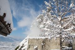 Megala Meteora monastery. Snow falls from the tree. royalty free stock photo