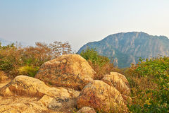 The megalith and mountains autumnal scenery Royalty Free Stock Photography