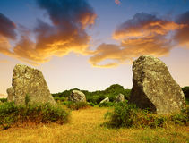 Megalithic monuments menhirs in Carnac. At sunset - Brittany, France stock photo