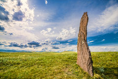 Megalithic rock on the field Royalty Free Stock Images
