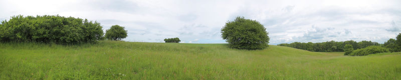 Megalithic tombs Sassen 3, 4 and 2 and tumulus Sassen in Mecklenburg-Vorpommern, Germany.  Royalty Free Stock Photo
