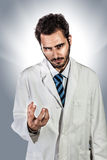 Megalomaniac doctor Stock Photo