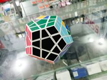 Megaminx Puzzle Cube. Colorful hard black puzzle kid play toll plastic intelegence smart playing Royalty Free Stock Photos