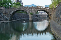 Meganebashi Spectacles Bridge. In Nagasaki, Japan.It`s a oldest stone arch bridge in Japan, and has been designated as an Important Cultural Property Stock Photos