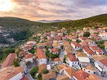 Meganisi Spartochori Village Greece. Meganisi is a Greek island and municipality immediately to the east-southeast of the island of Lefkada. The municipality stock photography
