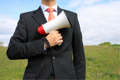 Megaphone 2. Businessman holding a megaphone ready to give an order Stock Image