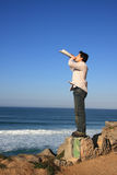 Megaphone. Young man speaking with a newspaper megaphone Royalty Free Stock Photos