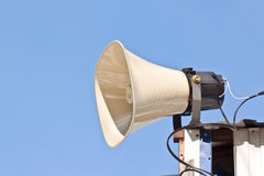 The Megaphone. With blue background Stock Photos
