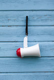 Megaphone on a blue wooden background Royalty Free Stock Images