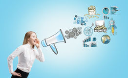 Megaphone and conceptual icons Stock Photo