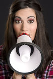 Bright Eyed Brunette Woman Speaks into Megaphone Stock Photo