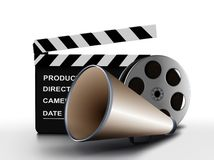 Megaphone and film reel with clapper. Board Royalty Free Stock Images