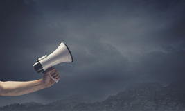 Megaphone in hand Royalty Free Stock Photos
