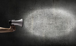 Megaphone in hand Stock Photography