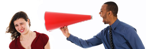 Megaphone Harrassement. Business man with megaphone harassing colleague Stock Photography