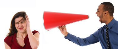 Megaphone Harrassement. Business man with megaphone harassing colleague Royalty Free Stock Image