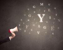 Megaphone with letters Royalty Free Stock Photos