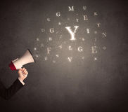 Megaphone with letters Royalty Free Stock Images