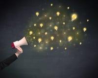 Megaphone with lightbulbs Stock Photo