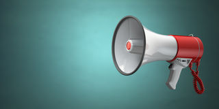 Megaphone or loudspeaker on green vintage background. Royalty Free Stock Photo
