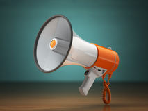 Megaphone or loudspeaker on green vintage background. Stock Photography