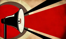 Megaphone or loudspeaker on grunge background Stock Images