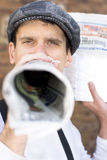 Megaphone News. Paper Boy Spruiks The News With A Rolled Up Newspaper Megaphone Royalty Free Stock Photography