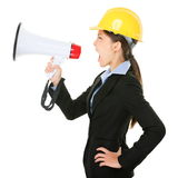 Megaphone screaming engineer contractor woman. Megaphone screaming engineer contractor business woman with hard hat yelling angry, mad and upset in profile Royalty Free Stock Photos