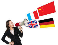 Megaphone speak foreign language. With german flag bubble Royalty Free Stock Images