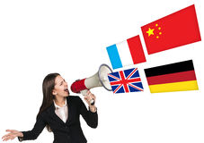 Megaphone speak foreign language. With german flag bubble Stock Images