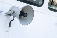Megaphone of a speaker phone on a vessel Stock Photo