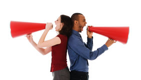 Megaphone Team. Two business people on isolated white with red megaphones Royalty Free Stock Images